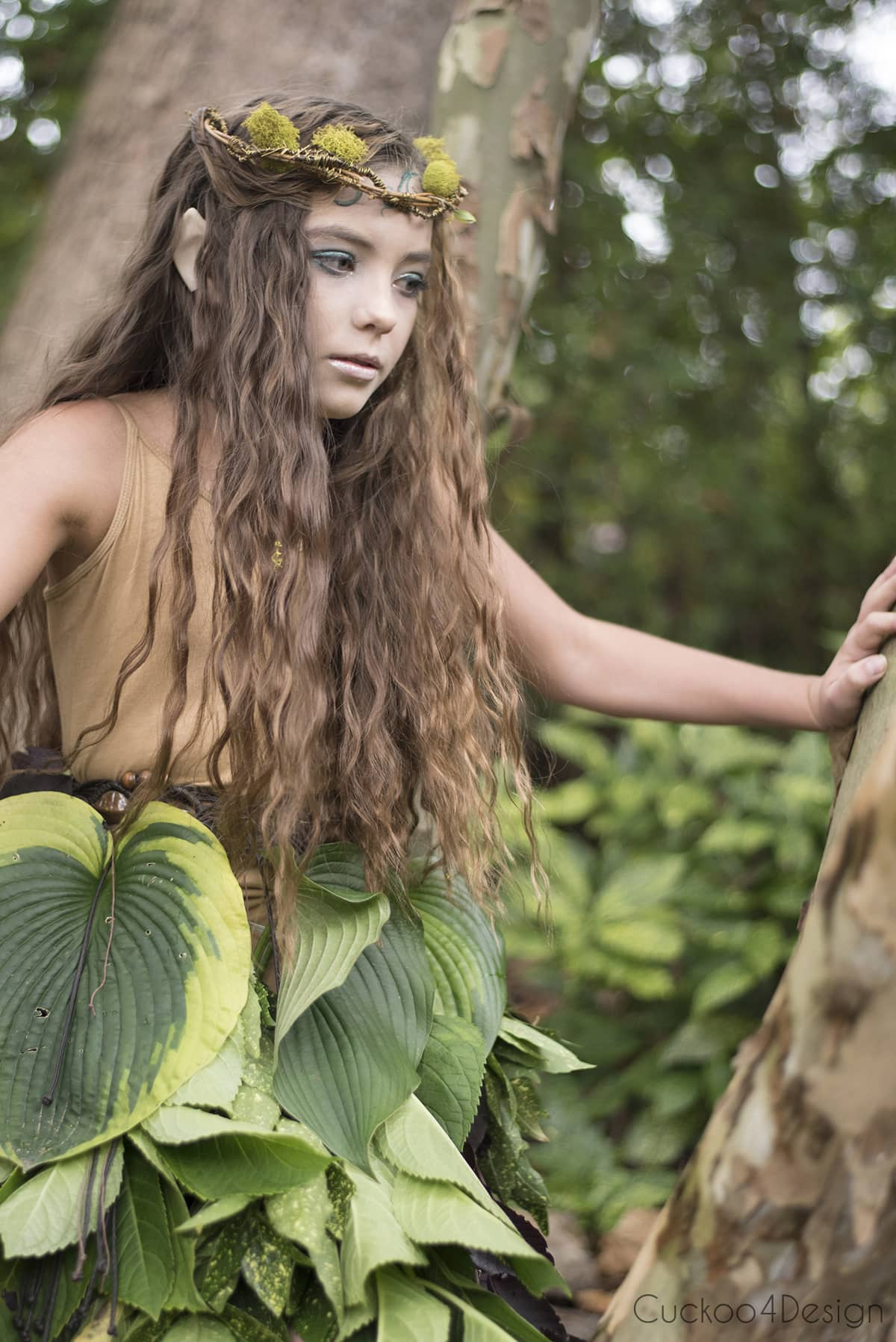 forest fairy sitting on a tree branch