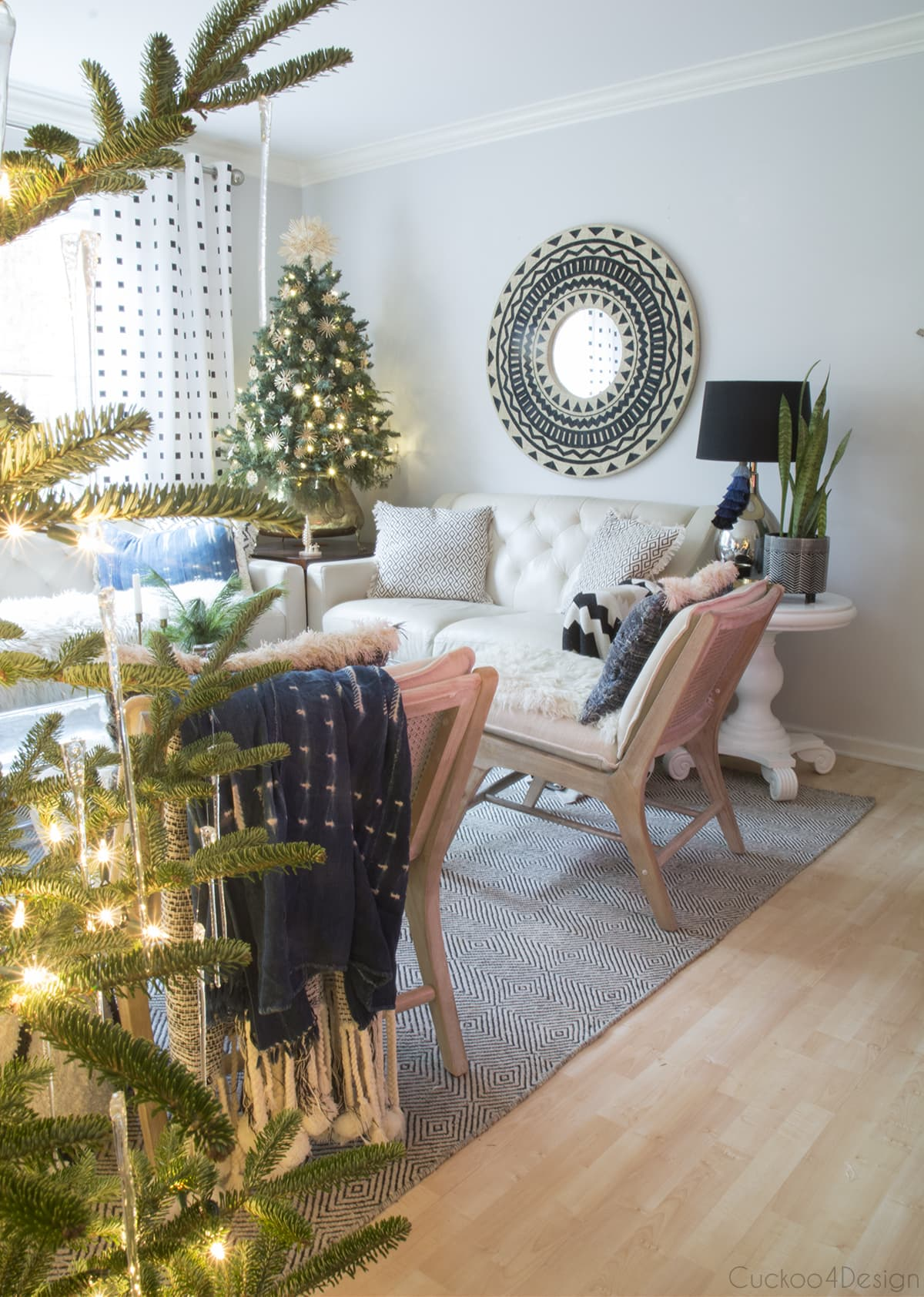 raffia mirror and straw star filled tree as natural Christmas decorations