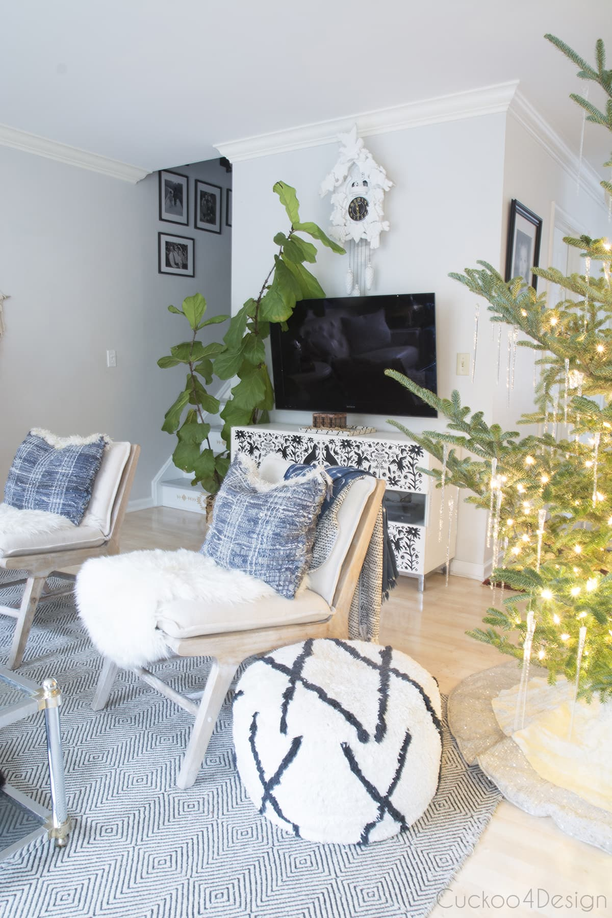 natural Christmas decorations around TV stand