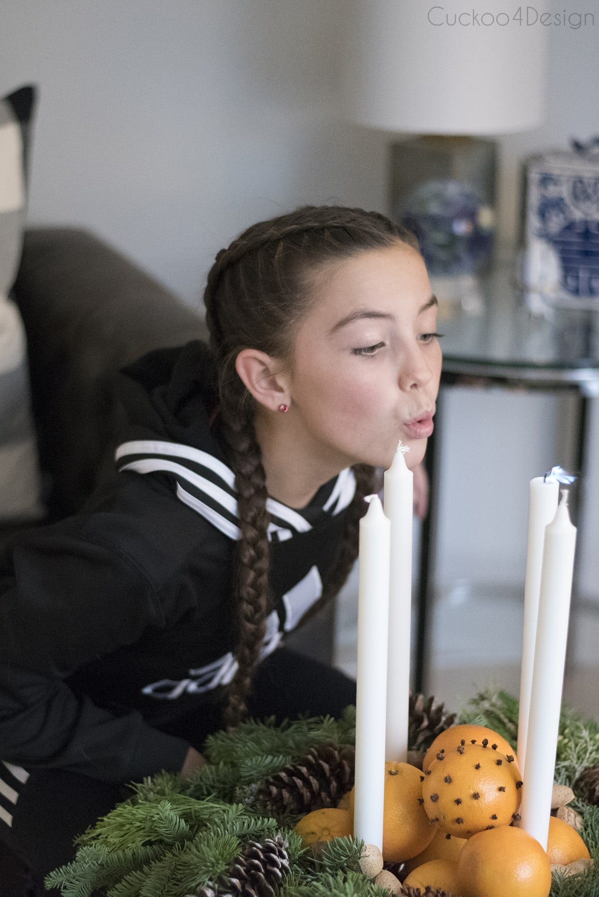 our daughter blowing out candles