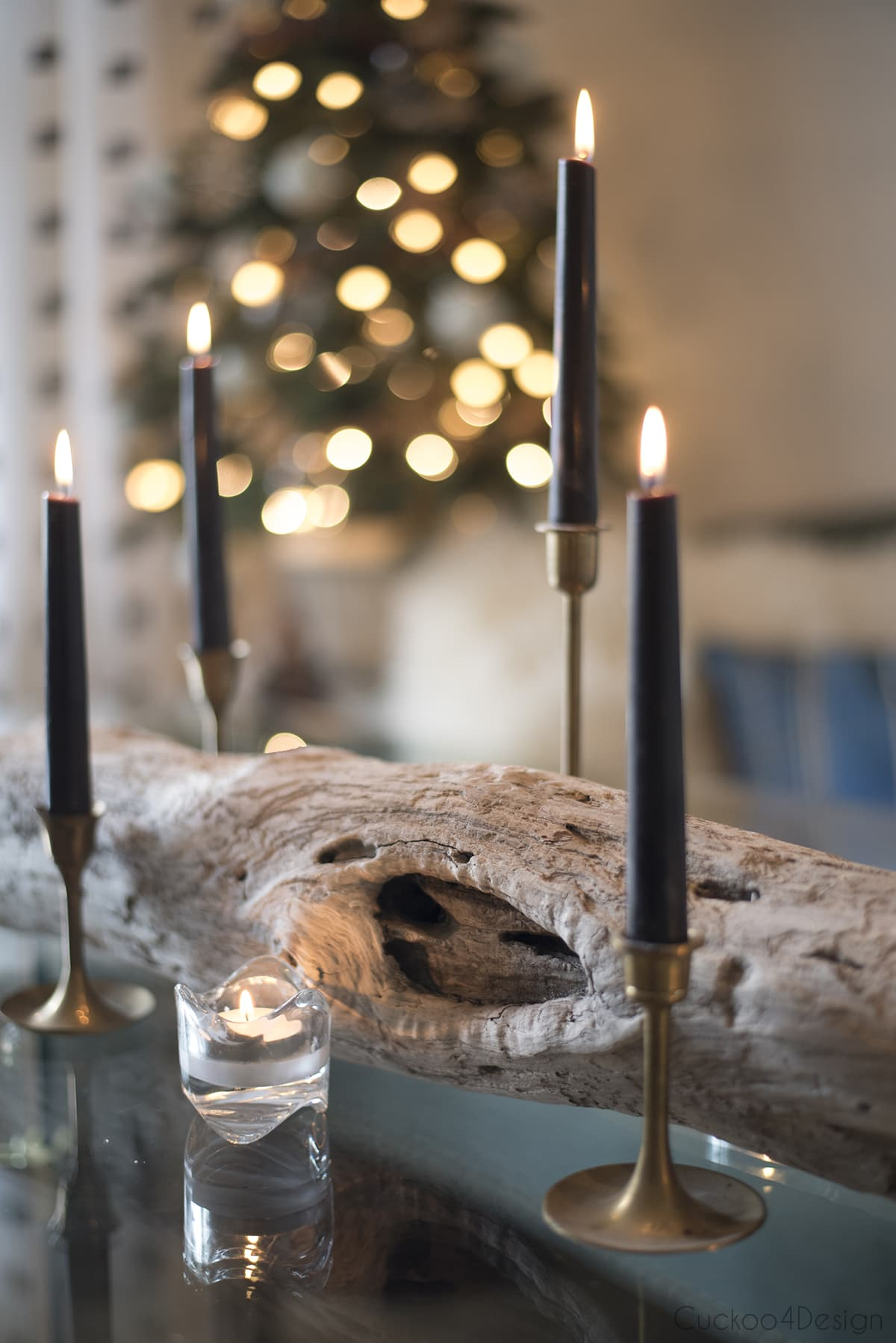 driftwood with candles as natural Christmas decorations