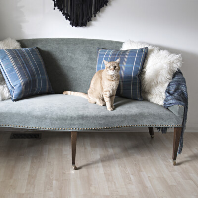 Raising a sofa with furniture casters to turn it into a dining settee bench