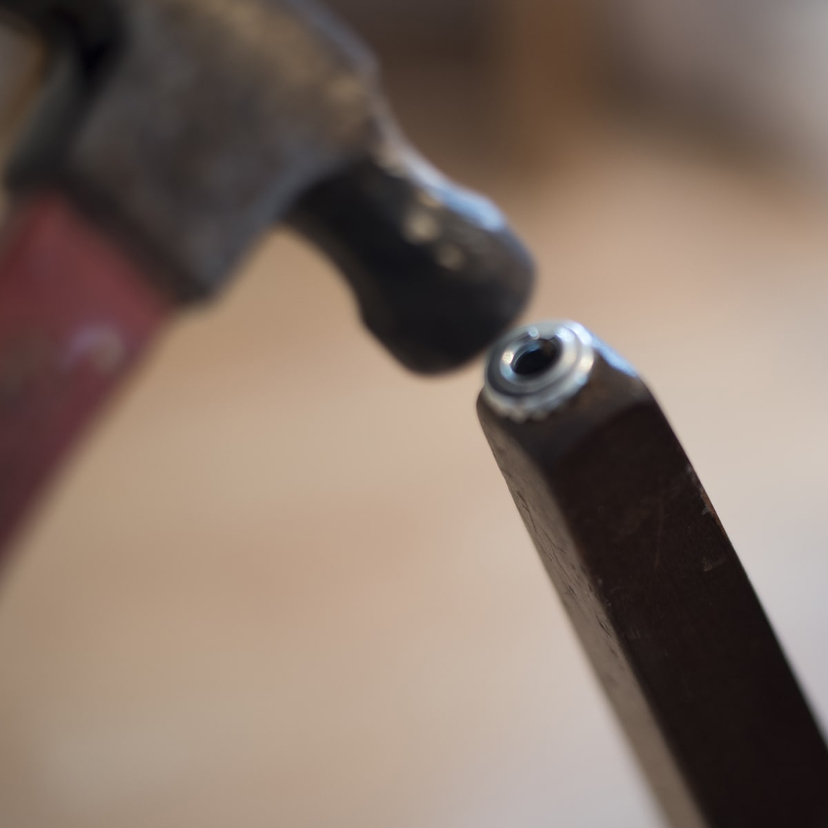 hammering sleeves into legs of dining settee bench