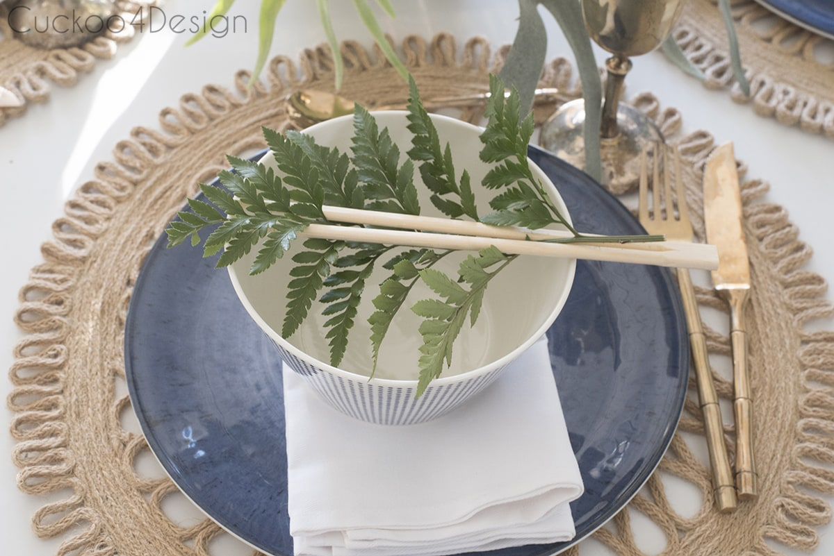 place setting on dining room table with ferns