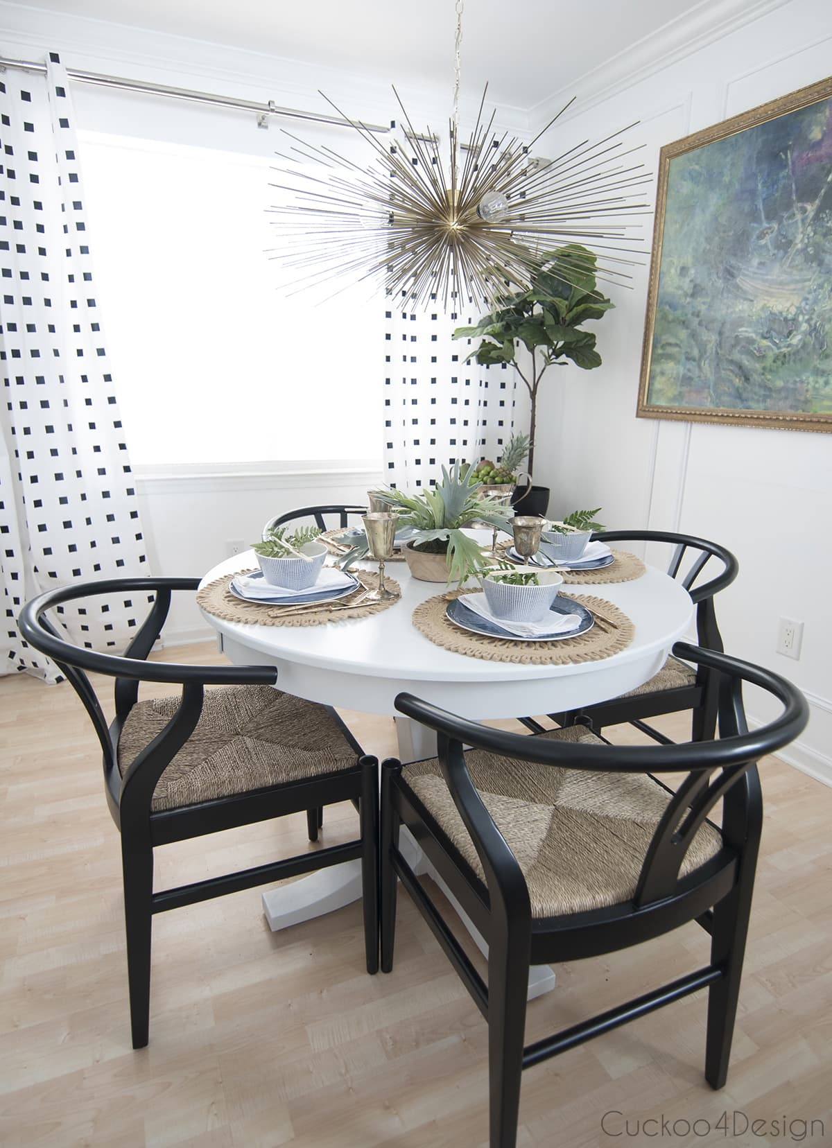 pedestal table with wishbone chairs