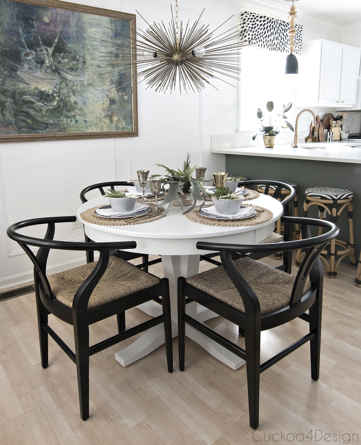 wishbone chairs around white pedestal table