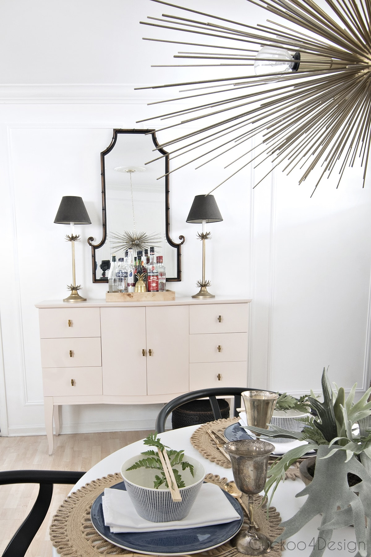 pink sideboard with bamboo mirror
