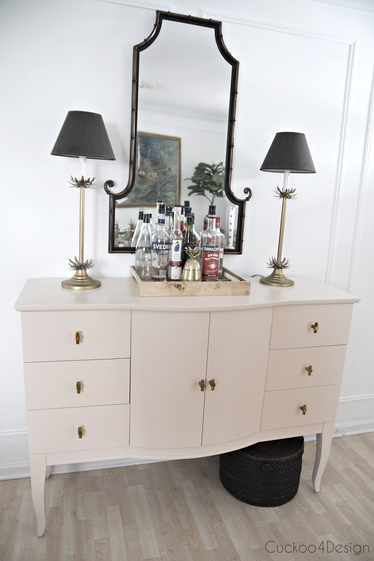 pink sideboard with metal bamboo mirror