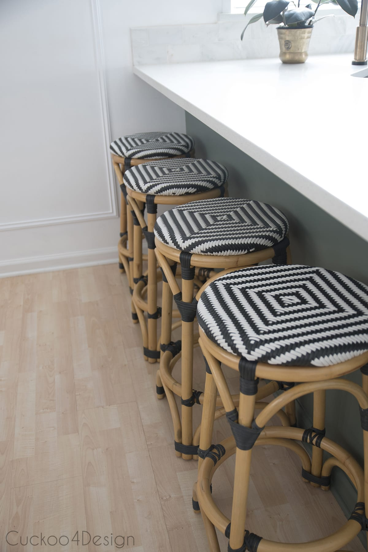 rattan black and white counter stools in green kitchen