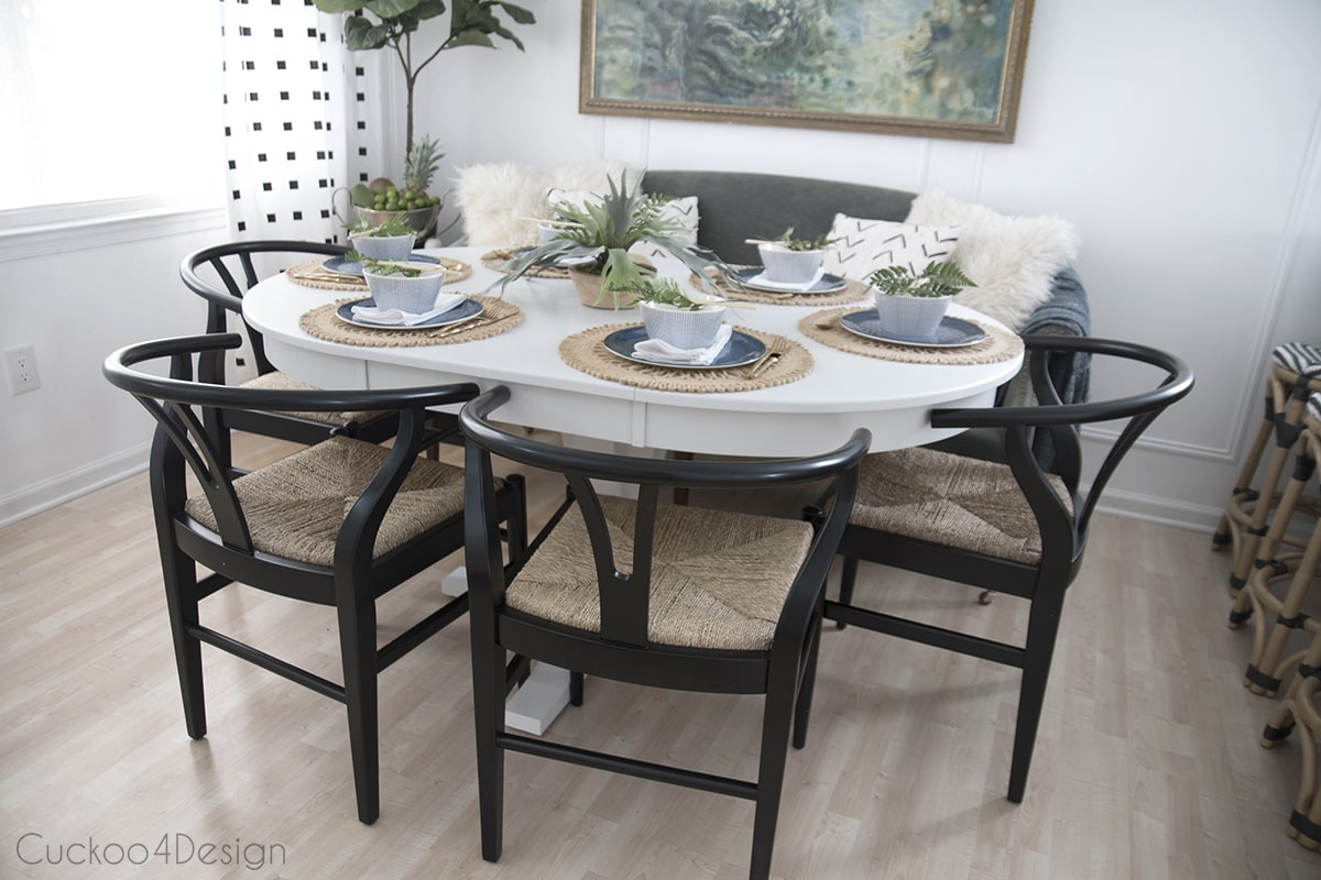 black wishbone chairs around white dining table