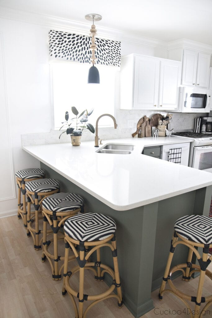 view of entire kitchen with green lower cabinets