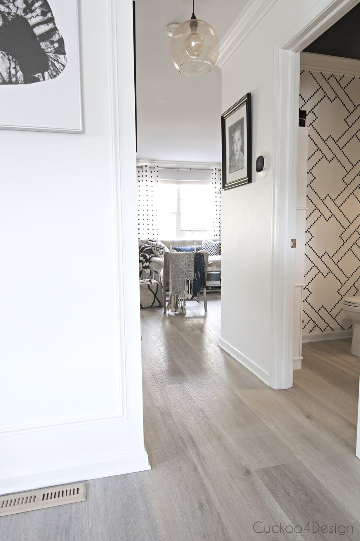 light colored vinyl wood plank flooring in hallway