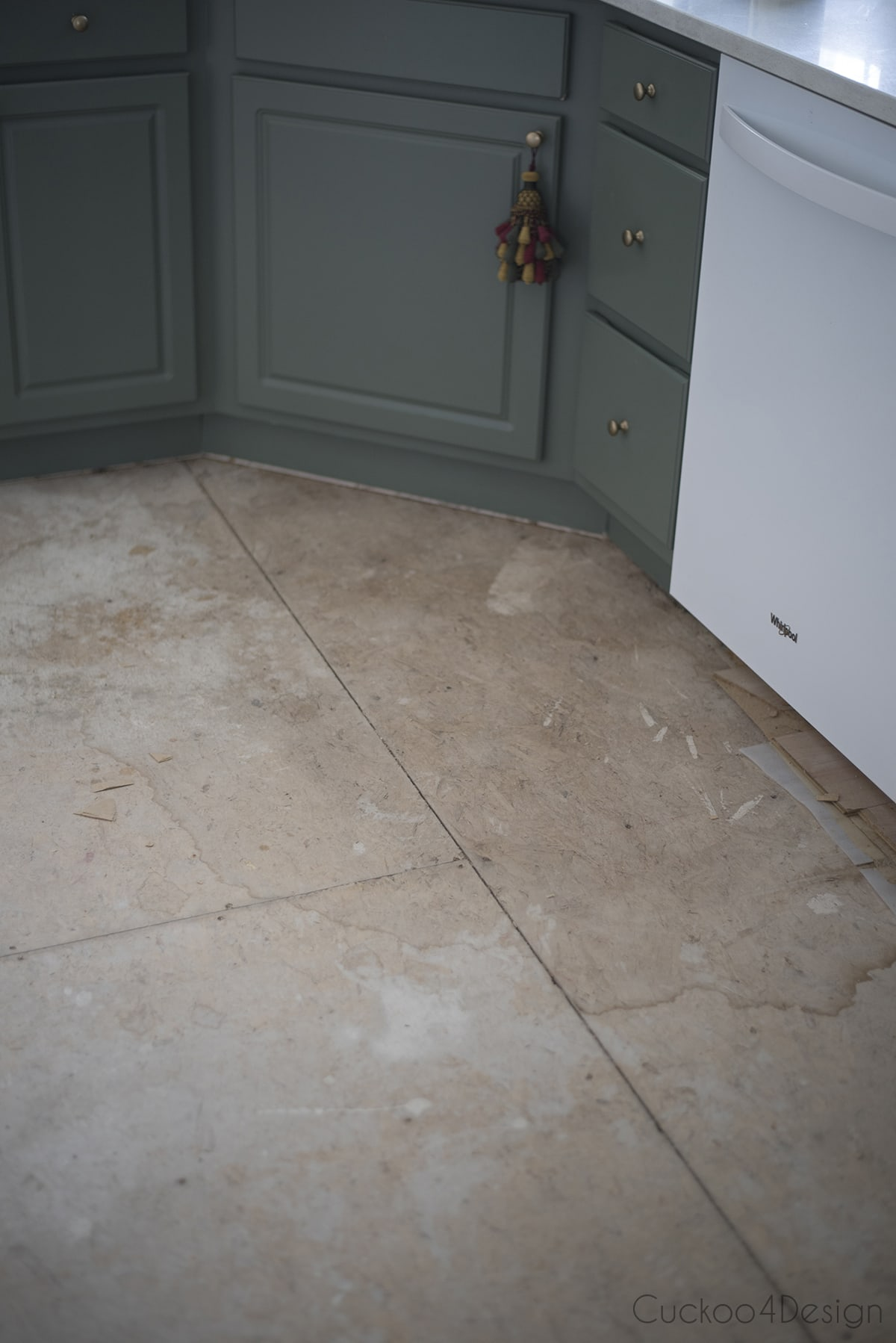 water stain on subfloor in kitchen
