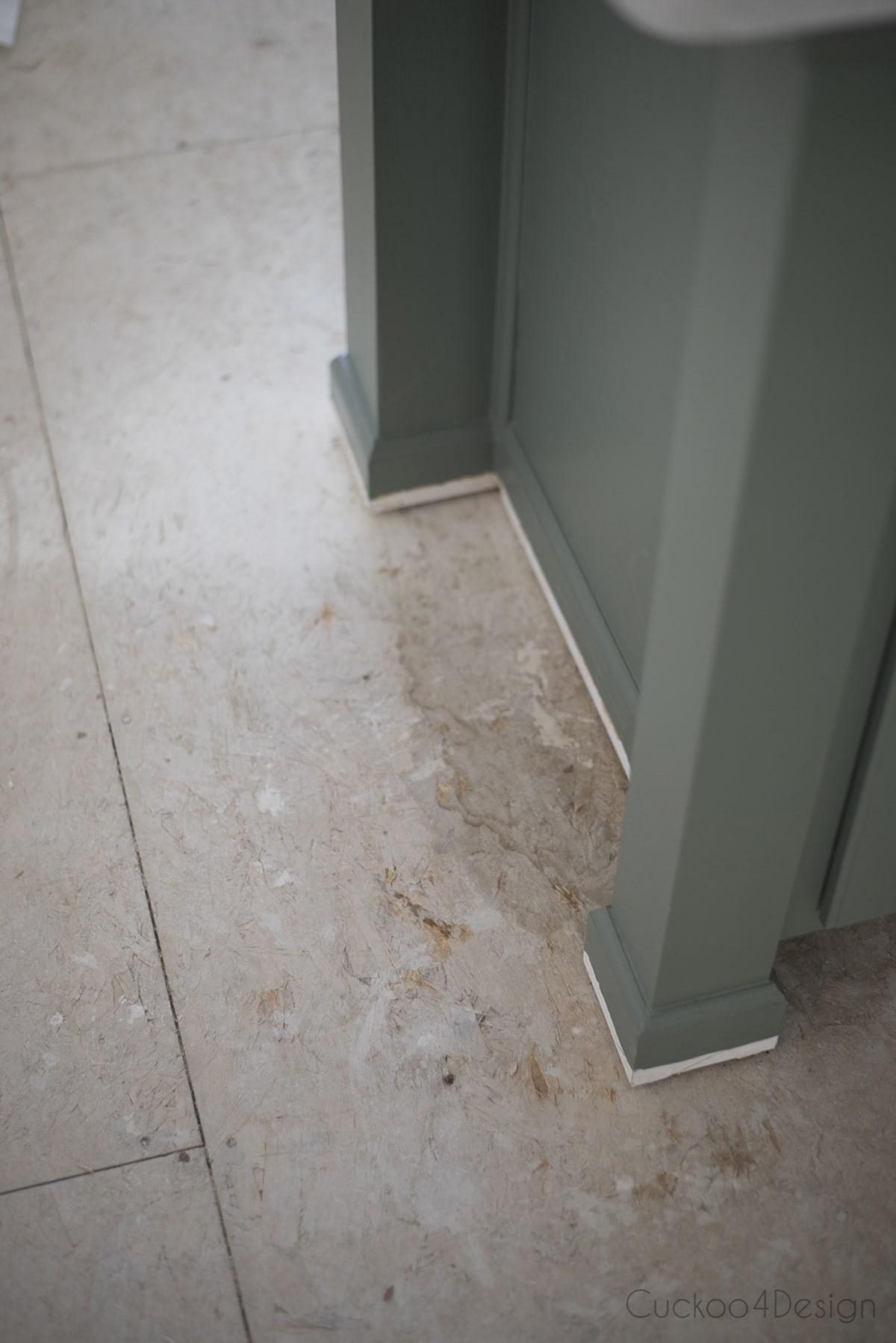 water stain under kitchen cabinet on subfloor