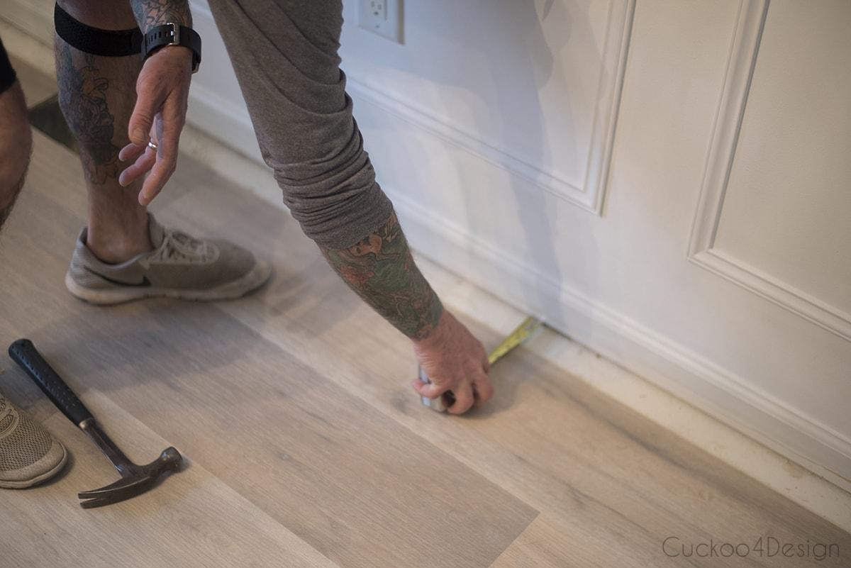 carefully measure vinyl wood plank flooring while installing