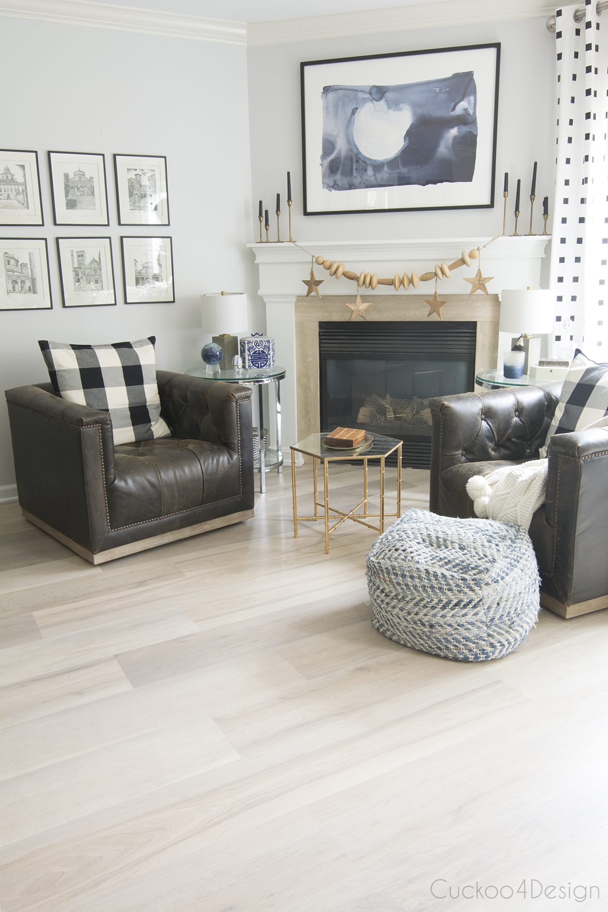 fireplace areas with vinyl wood plank flooring
