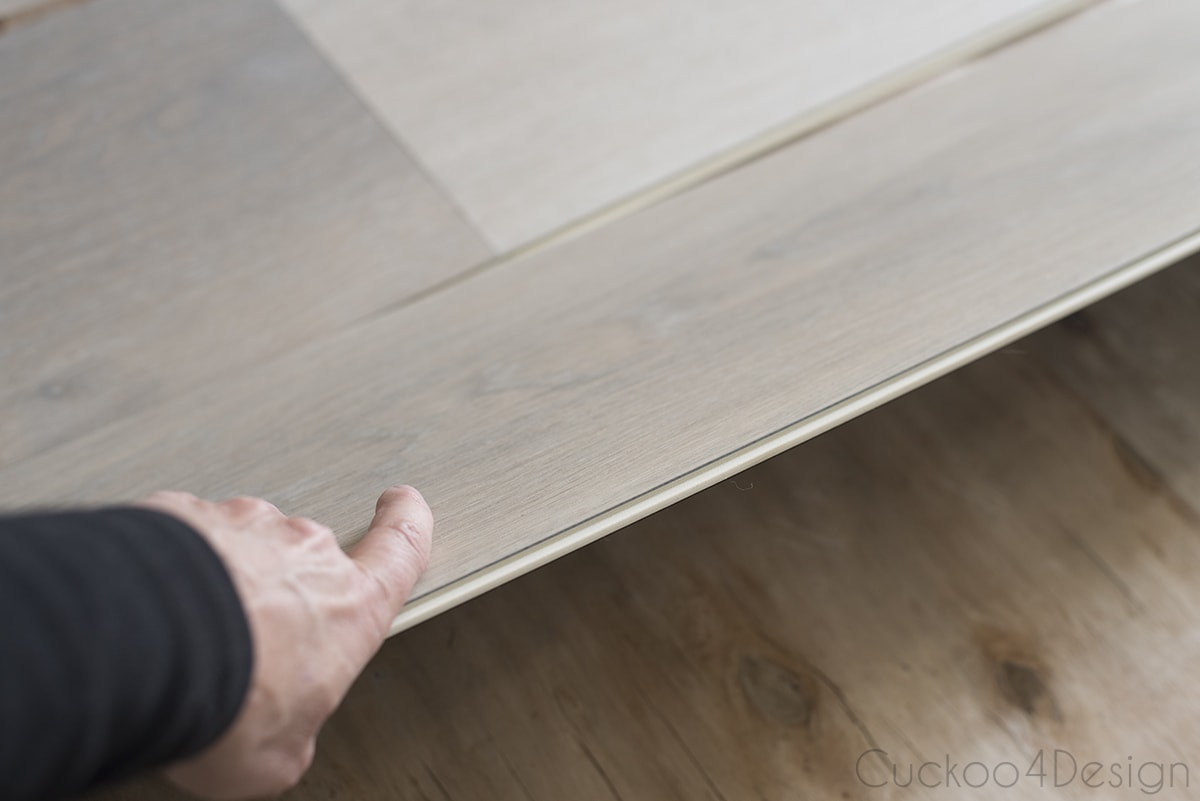 sliding and clicking in vinyl wood plank flooring