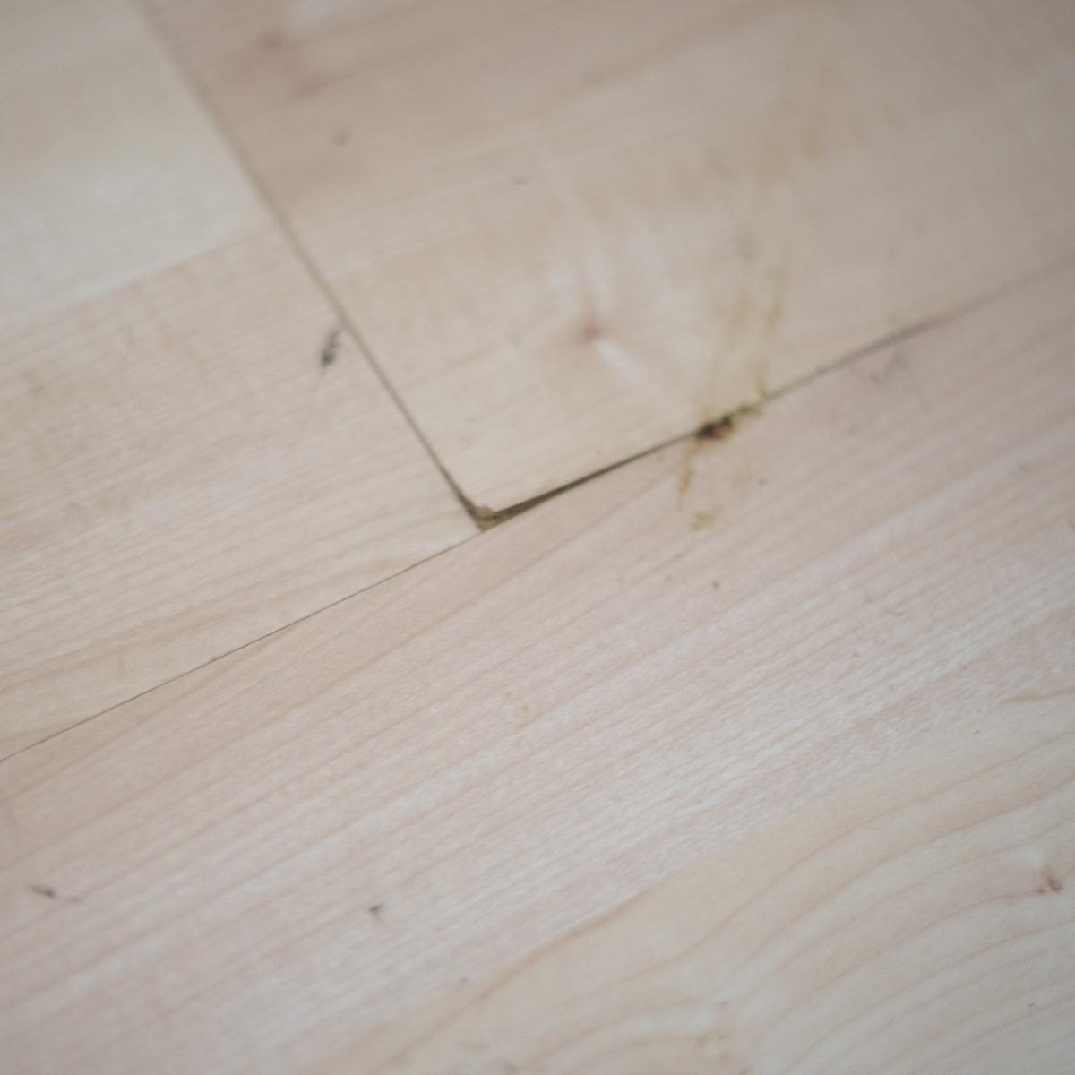 broken laminate before installing vinyl wood plank flooring