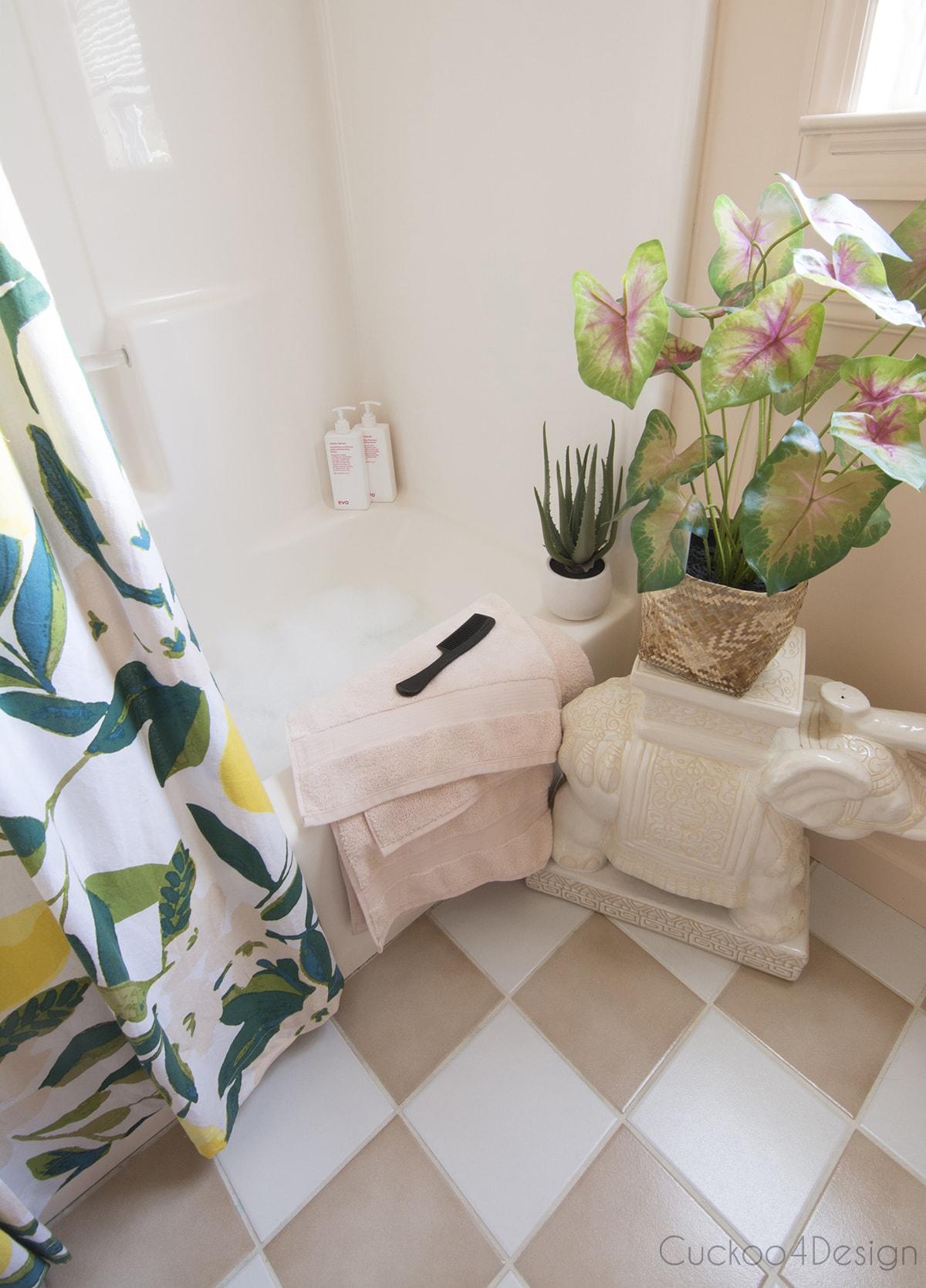 vintage checkerboard tile in blush budget bathroom remodel