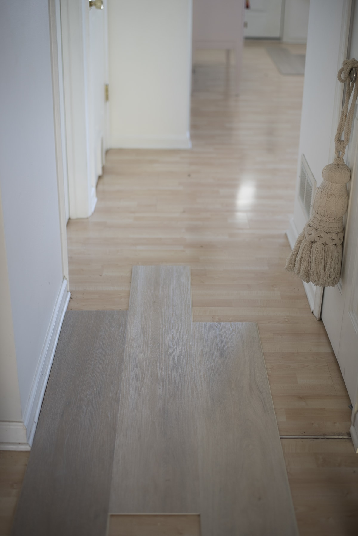 the different look between maple laminate and white ash vinyl wood plank flooring