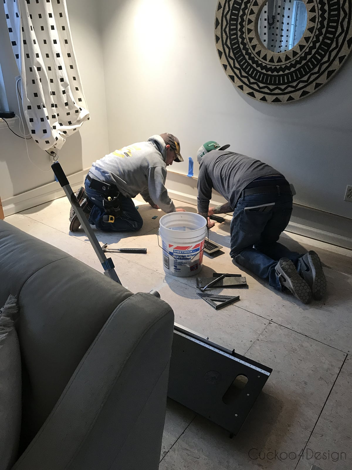 starting vinyl wood plank flooring installation in living room