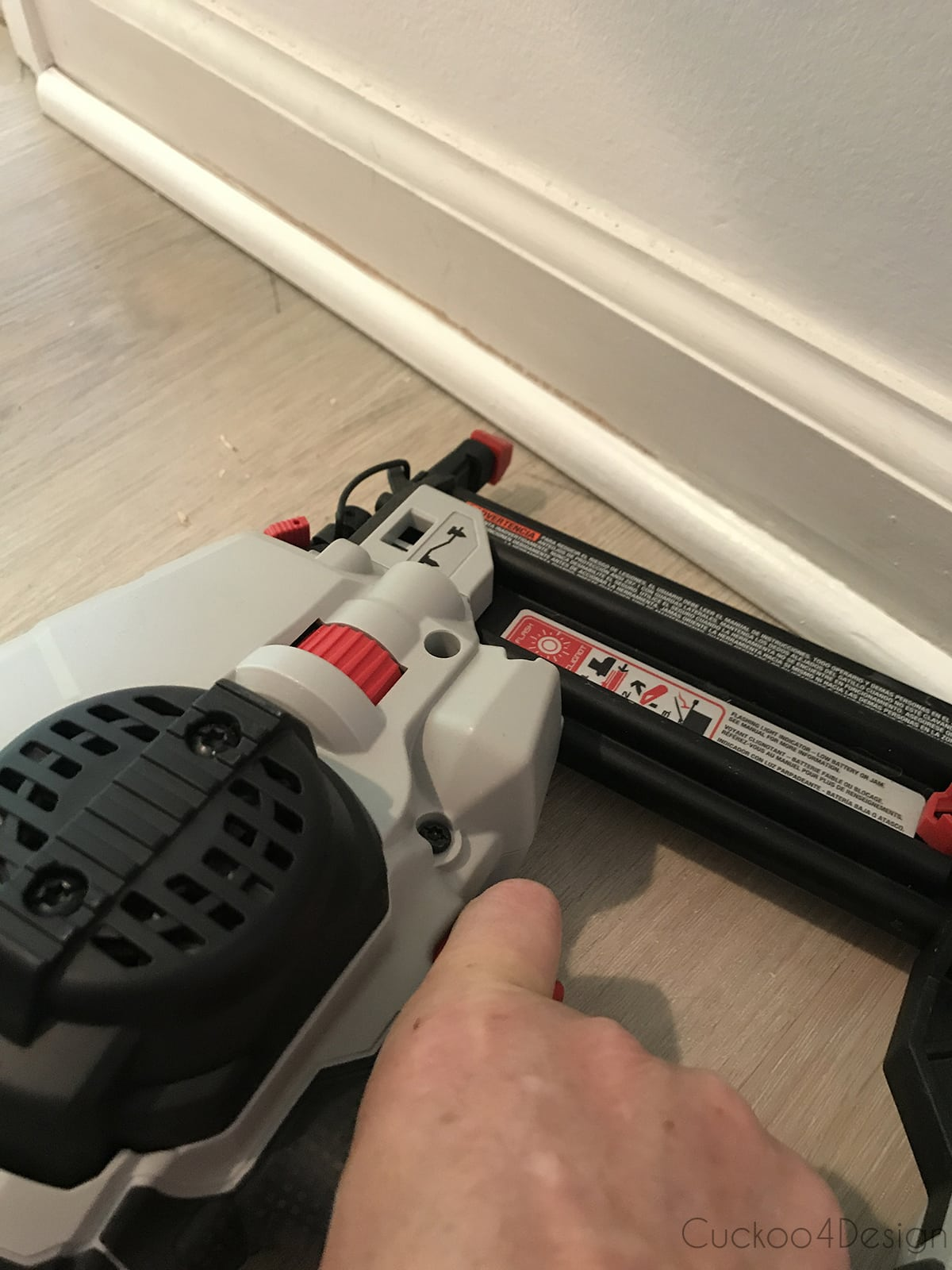 attaching quarter round molding with brad nailer after vinyl wood plank flooring installation
