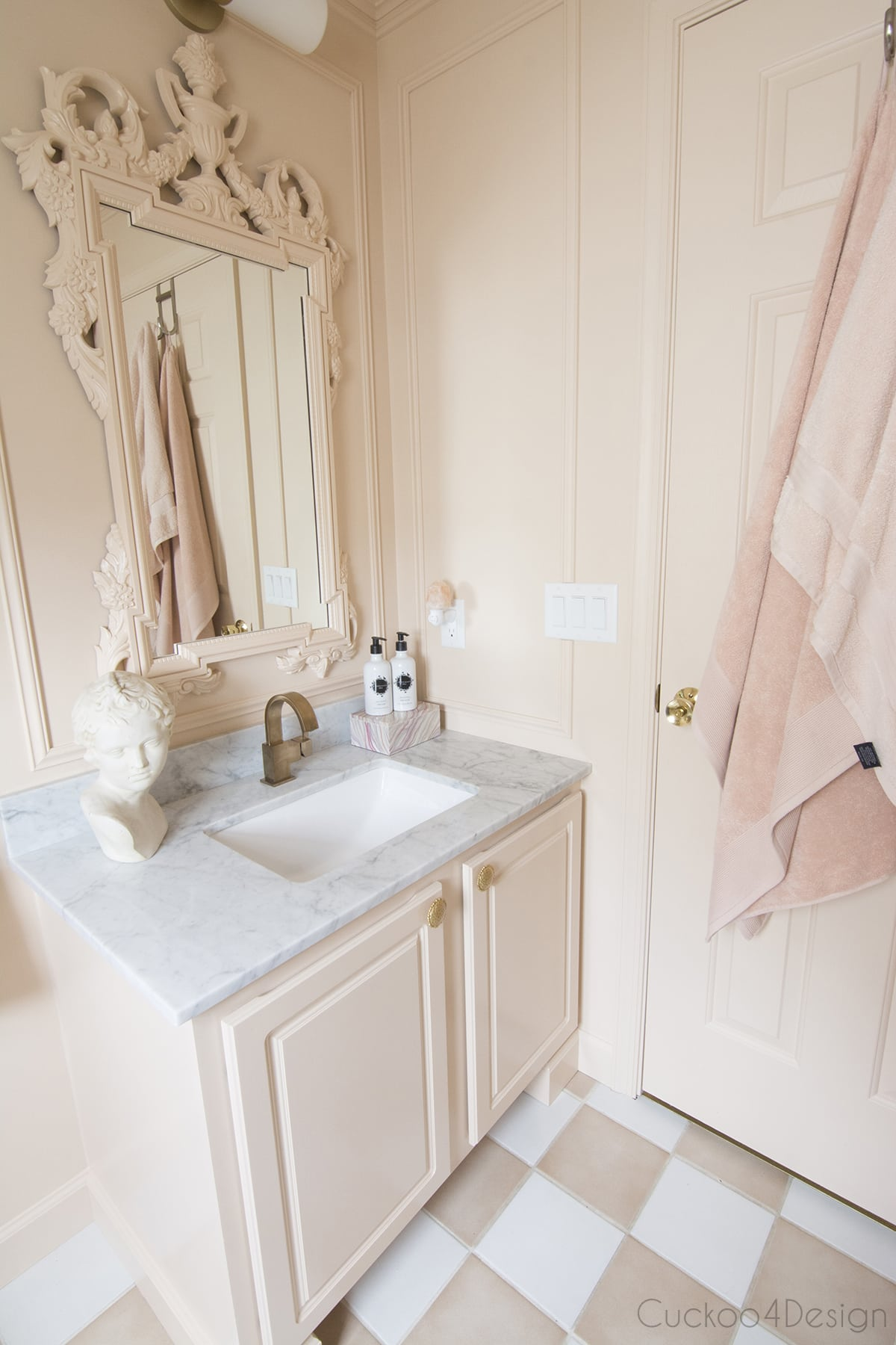 side view of blush and marble budget bathroom remodel