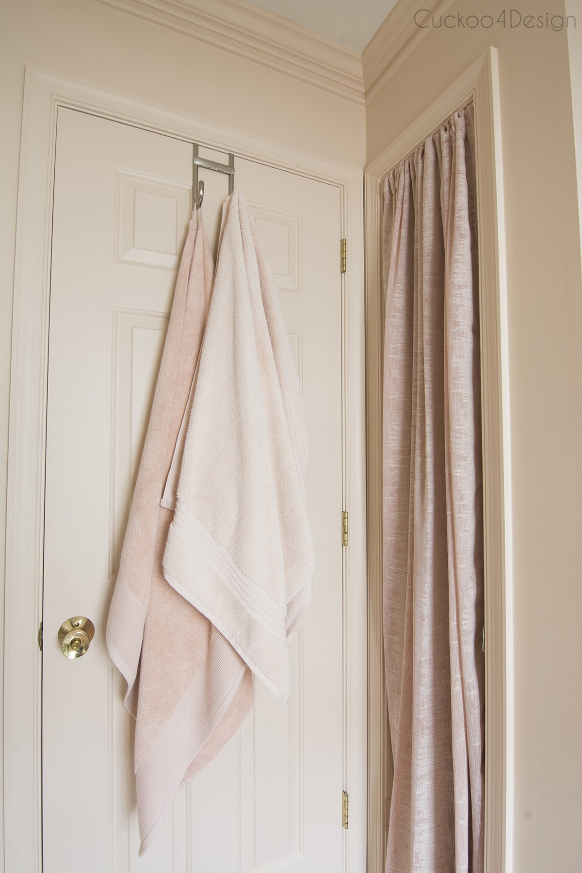 blush towels and curtains in blush budget bathroom remodel
