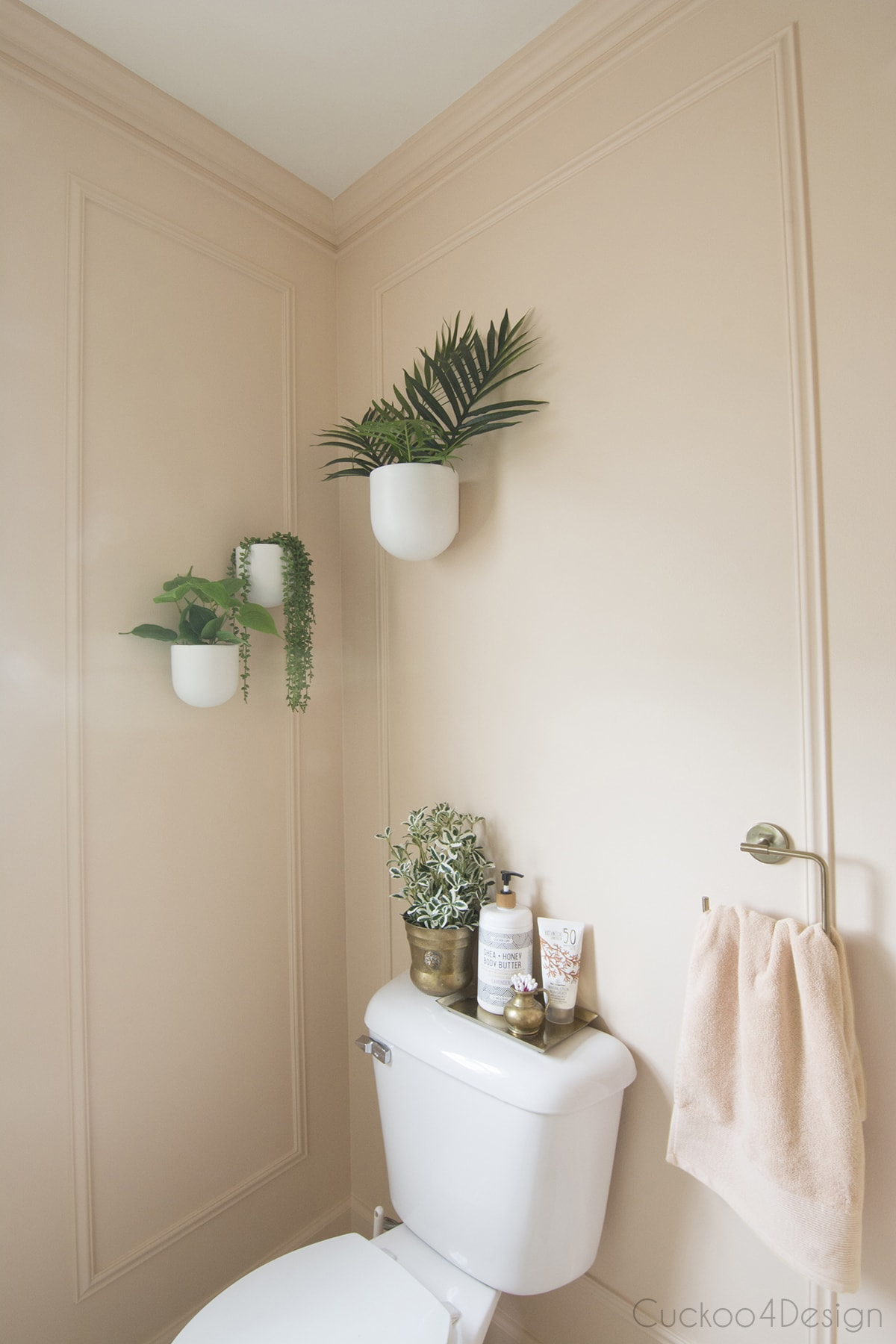 wall planters above toilet in budget bathroom remodel