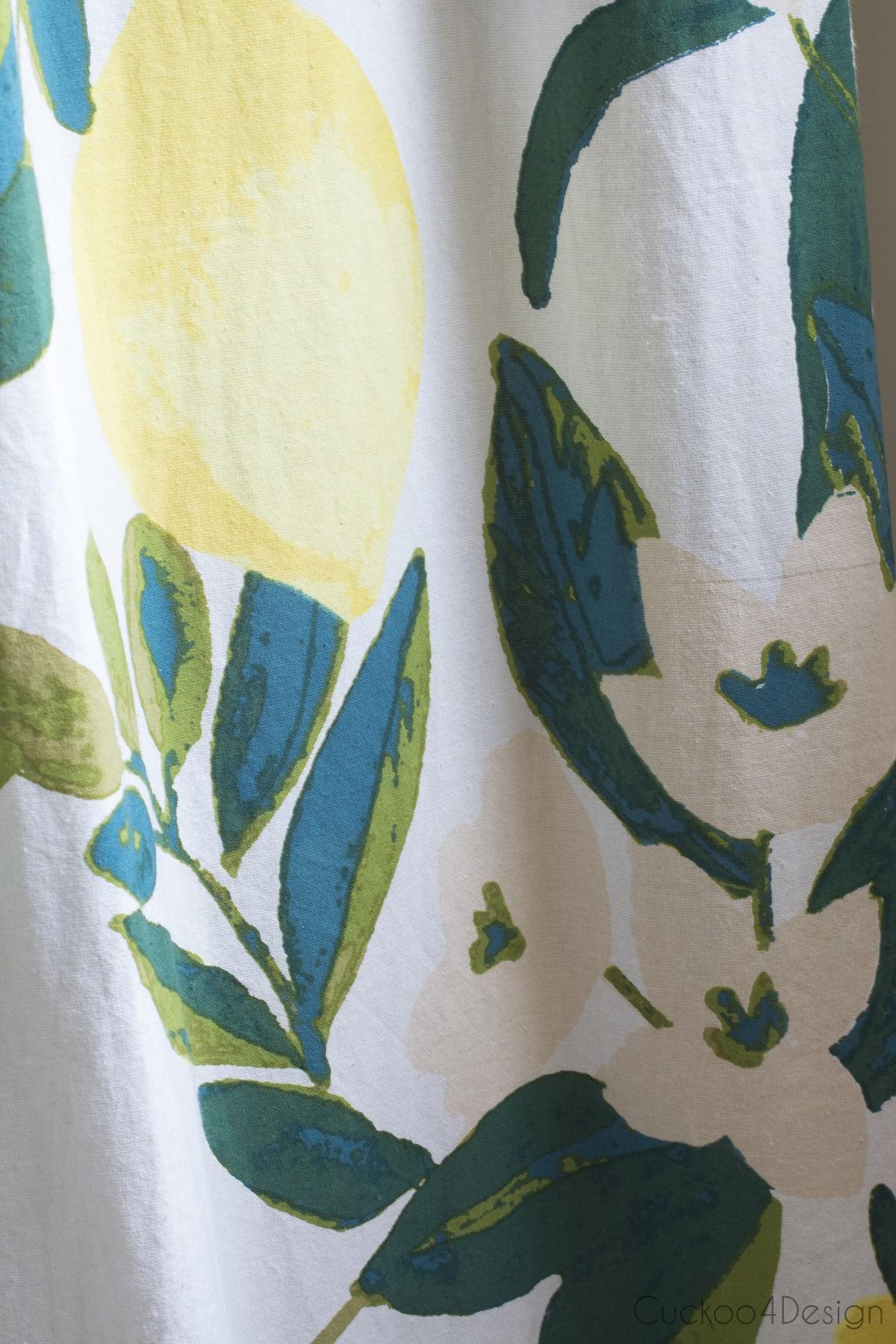 lemon shower curtain in budget bathroom remodel