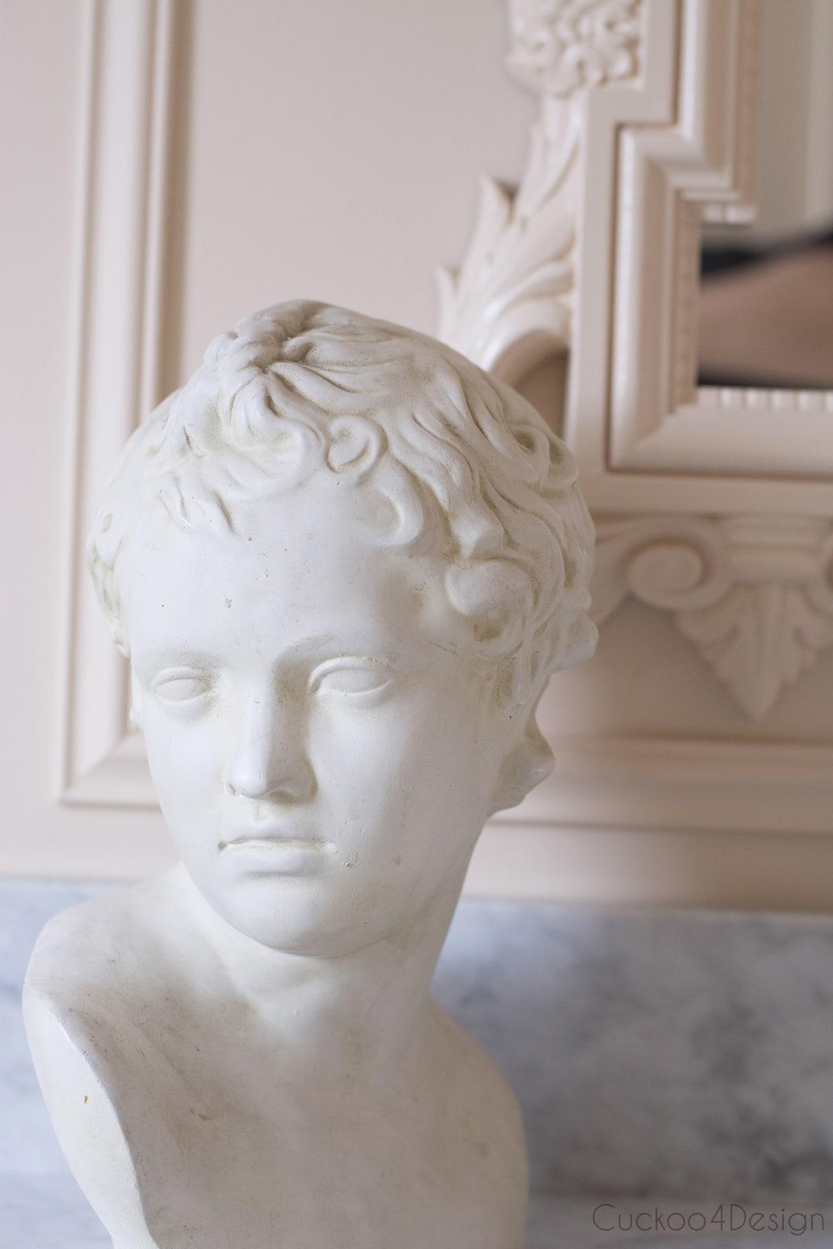 Greek bust in budget bathroom remodel