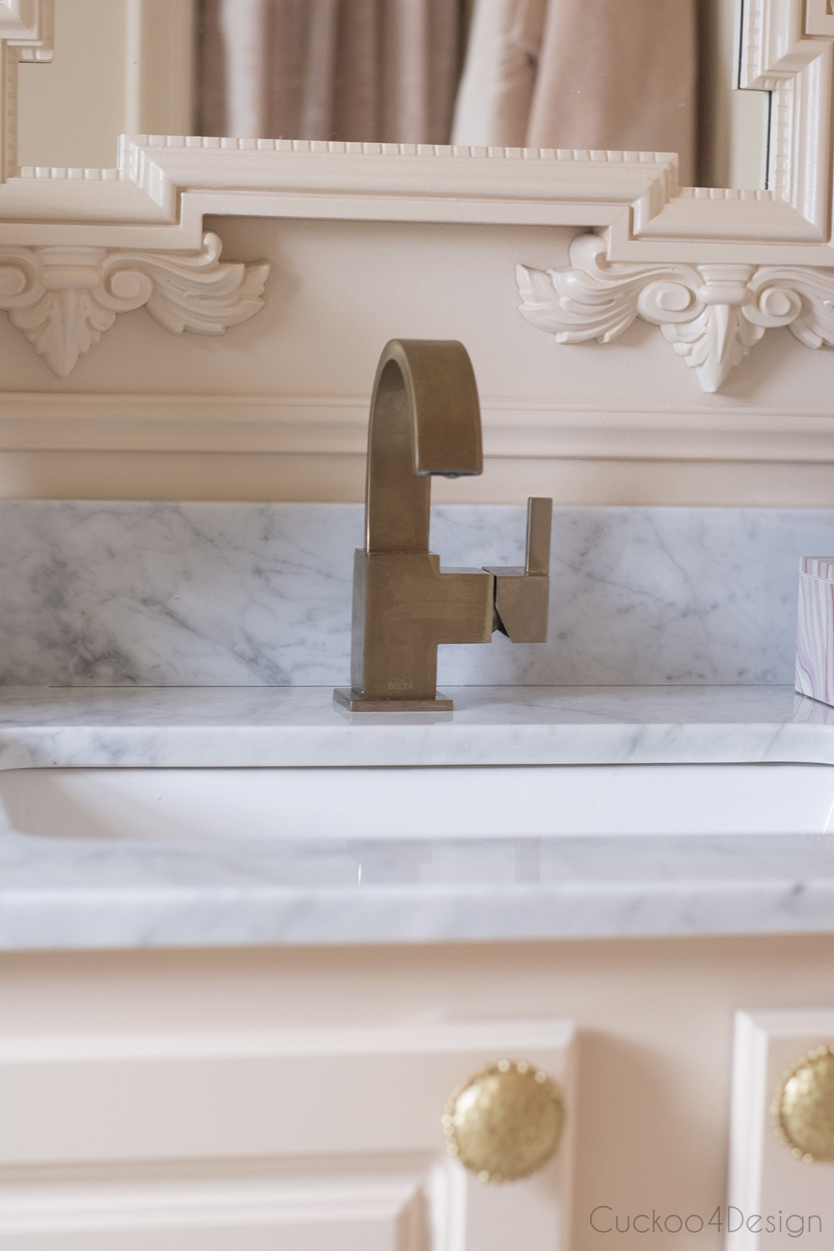 brass faucet in blush budget bathroom remodel