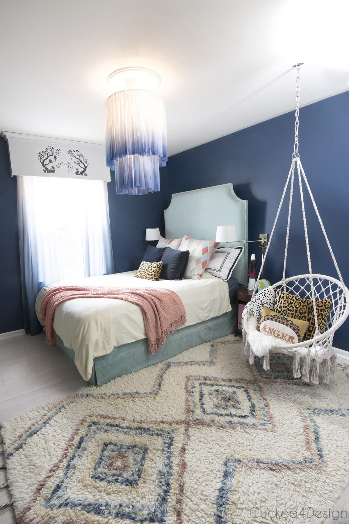 lit white and blue chandelier in bedroom