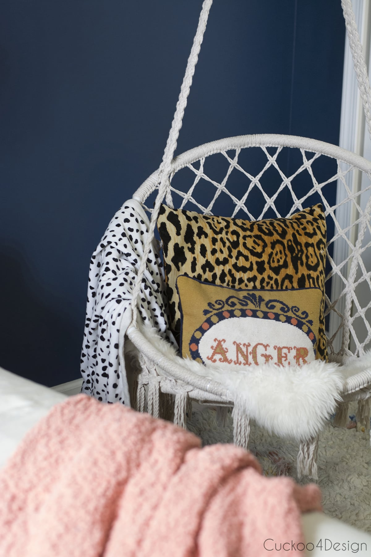 macrame hanging chair with leopard throw pillow