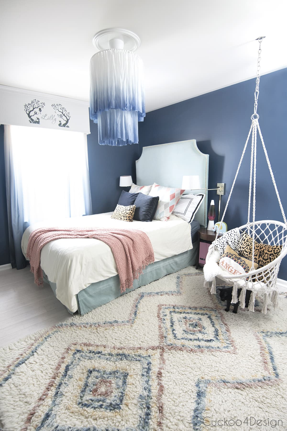 dark blue girl's bedroom with macrame chair