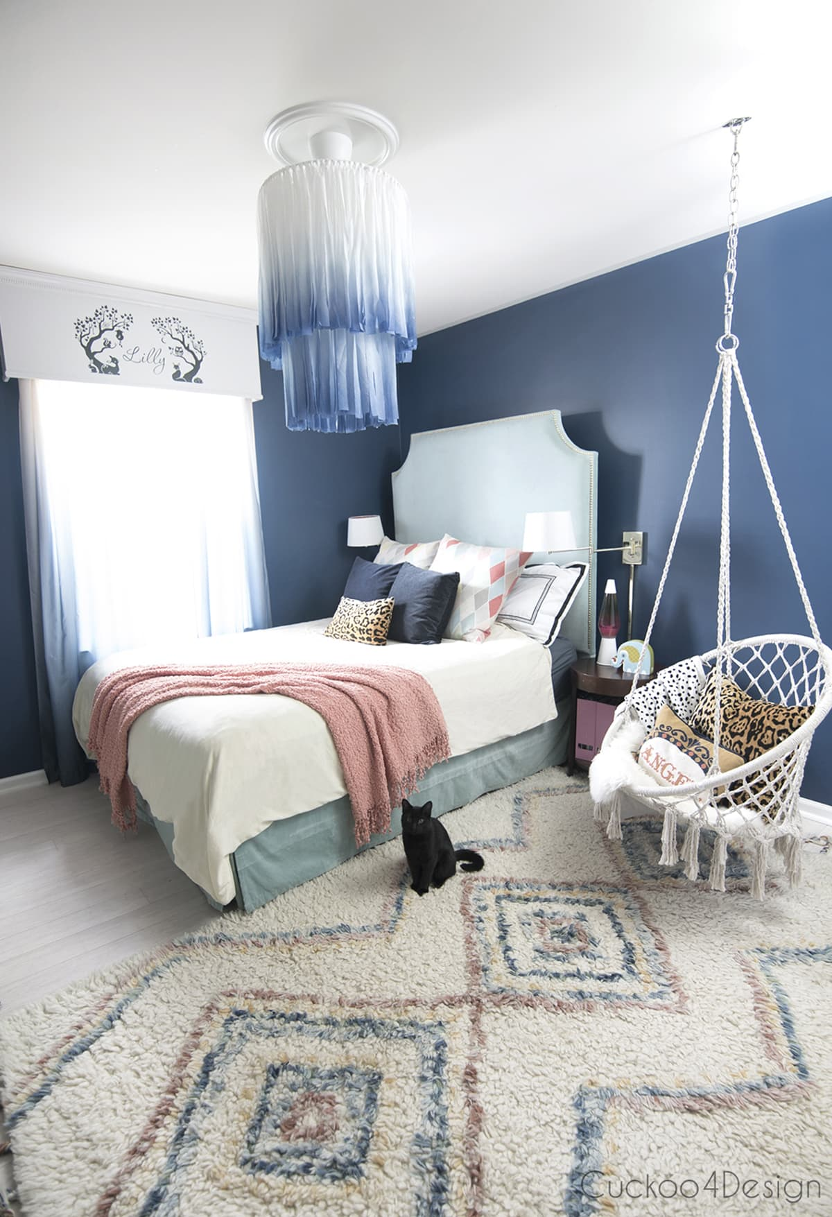 white and blue chandelier in dark blue bedroom