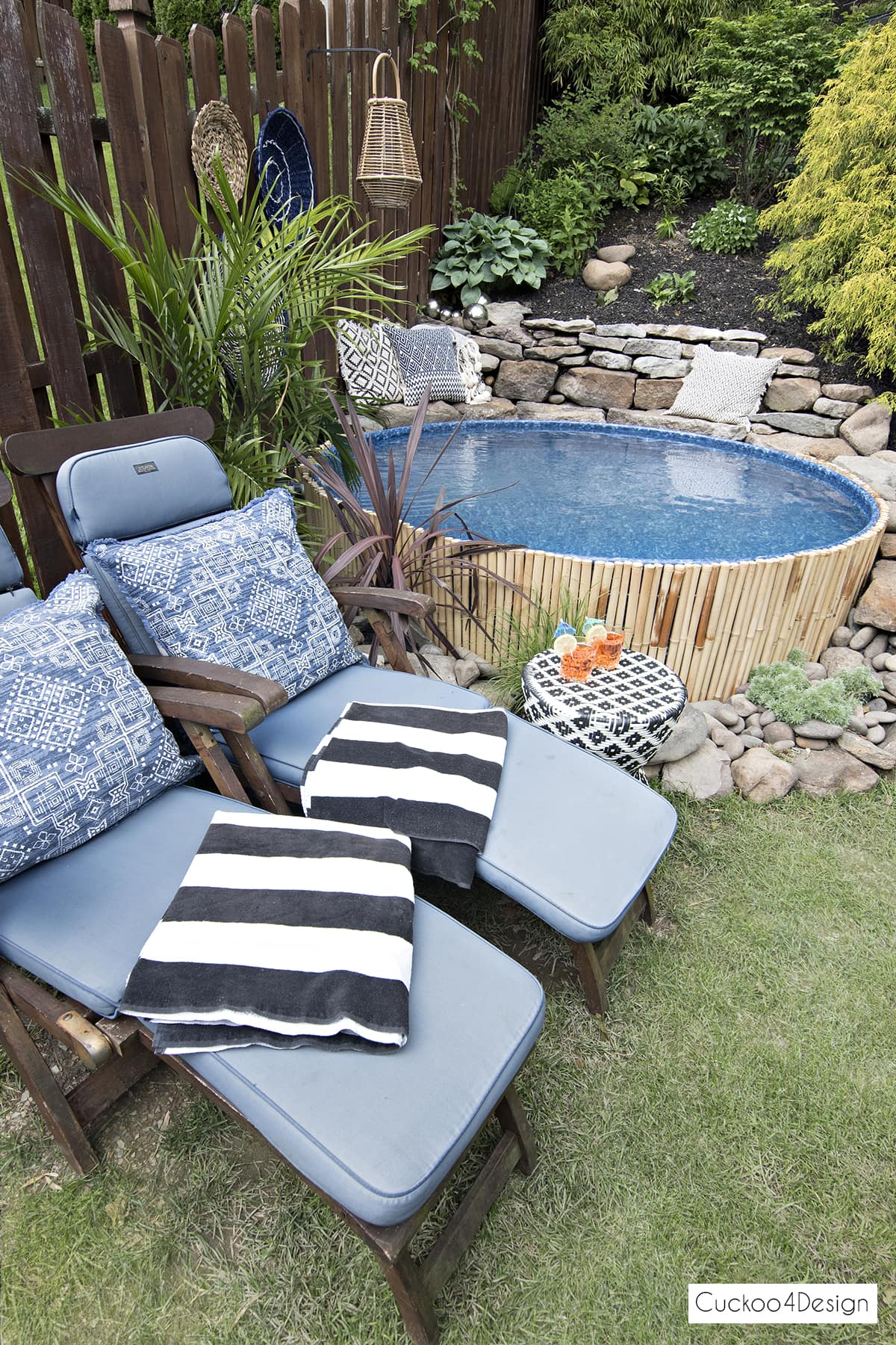 blue steamer loungers next to stock tank swimming pool
