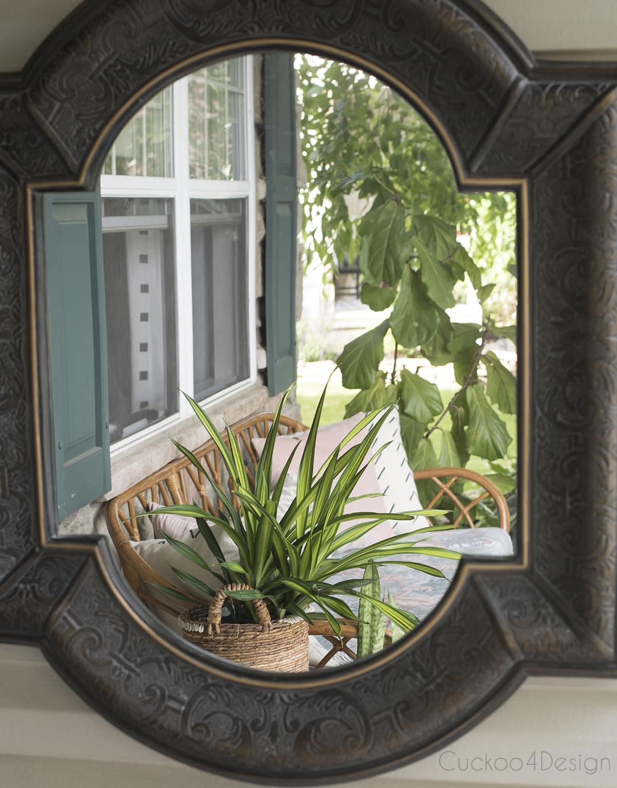 mirror on front porch with rattan sofa
