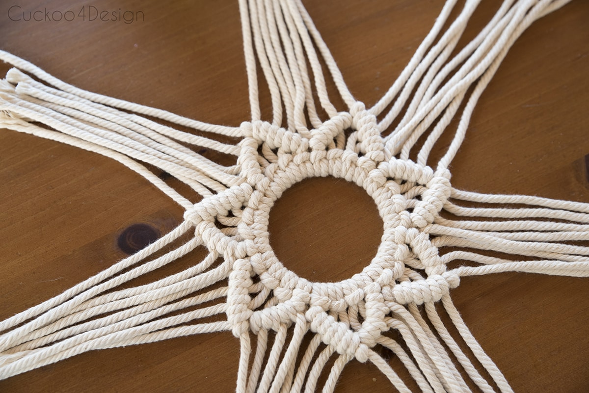 growing sections of yarn for macrame wreath tutorial