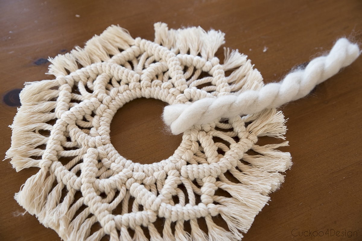 cut pieces of thick wool to weave through macrame wreath