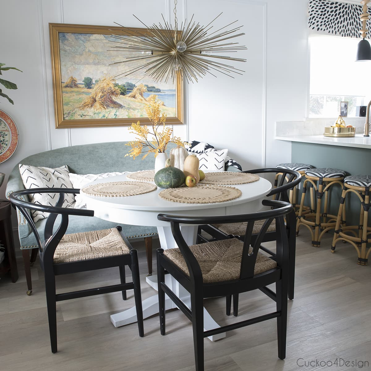 wishbone chairs in green eat-in-kitchen with modern touches and family heirlooms