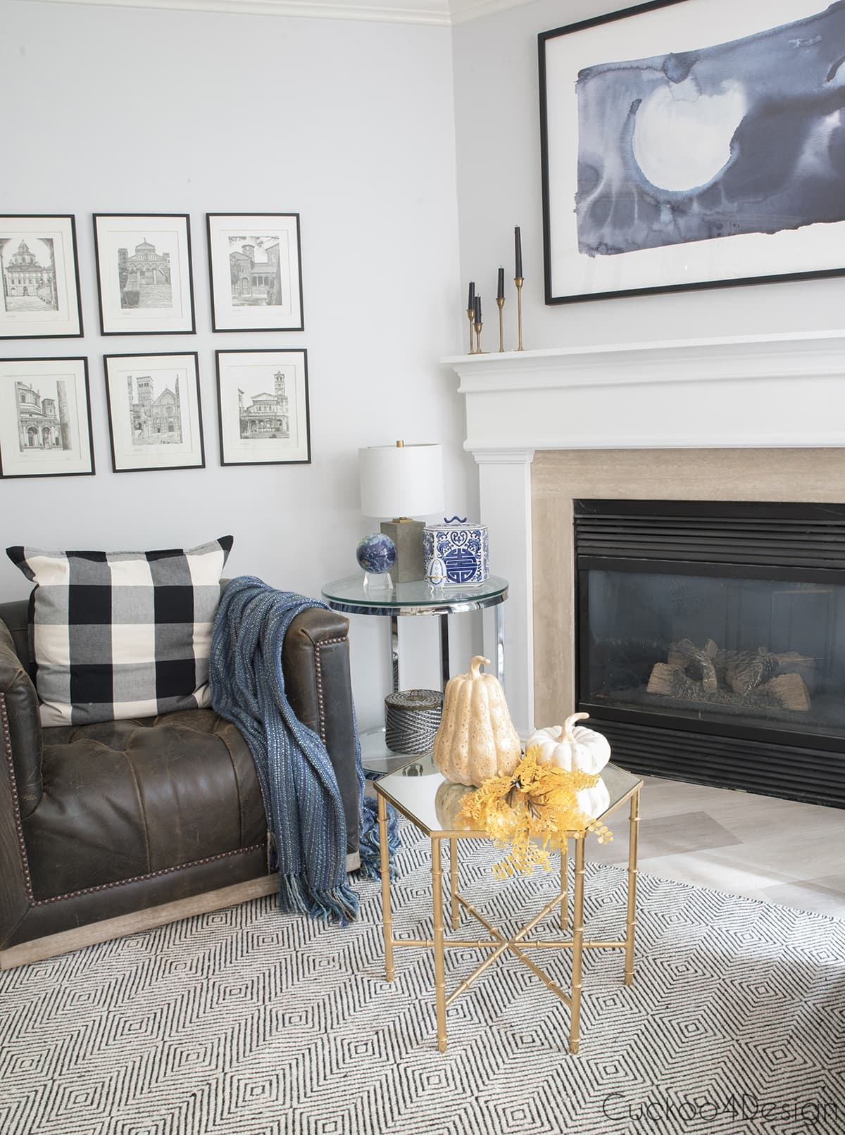 fireplace area with leather swivel chairs and blue accents