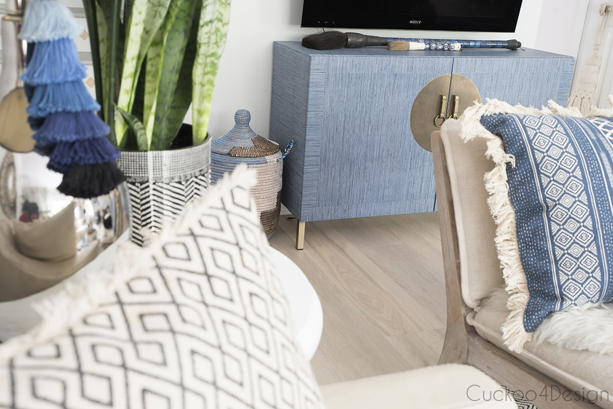side view of Ikea Besta makeover with faux peel and stick grasscloth wallpaper