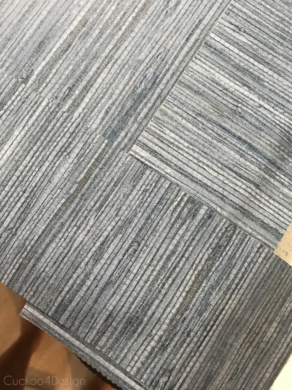 letting peel and stick grasscloth wallpaper overlap before cutting