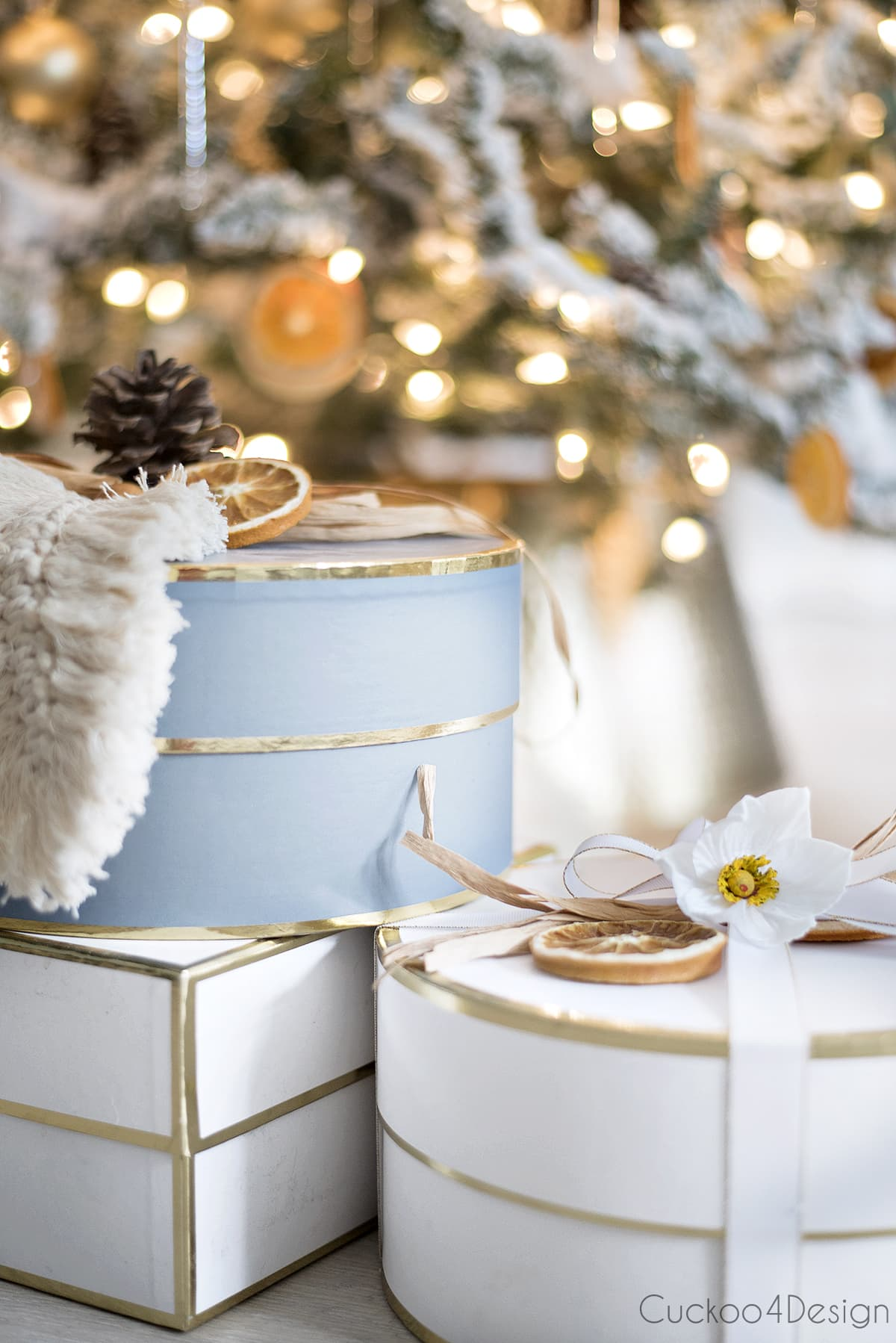 blue, white and gold wrapped presents with dried orange slices and German Christmas rose