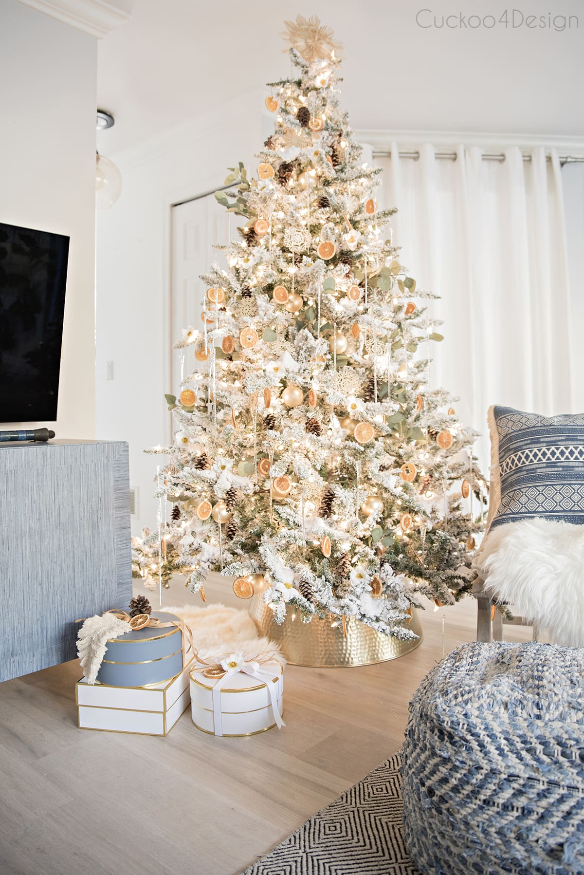 blue accent in modern boho home with German Christmas tree