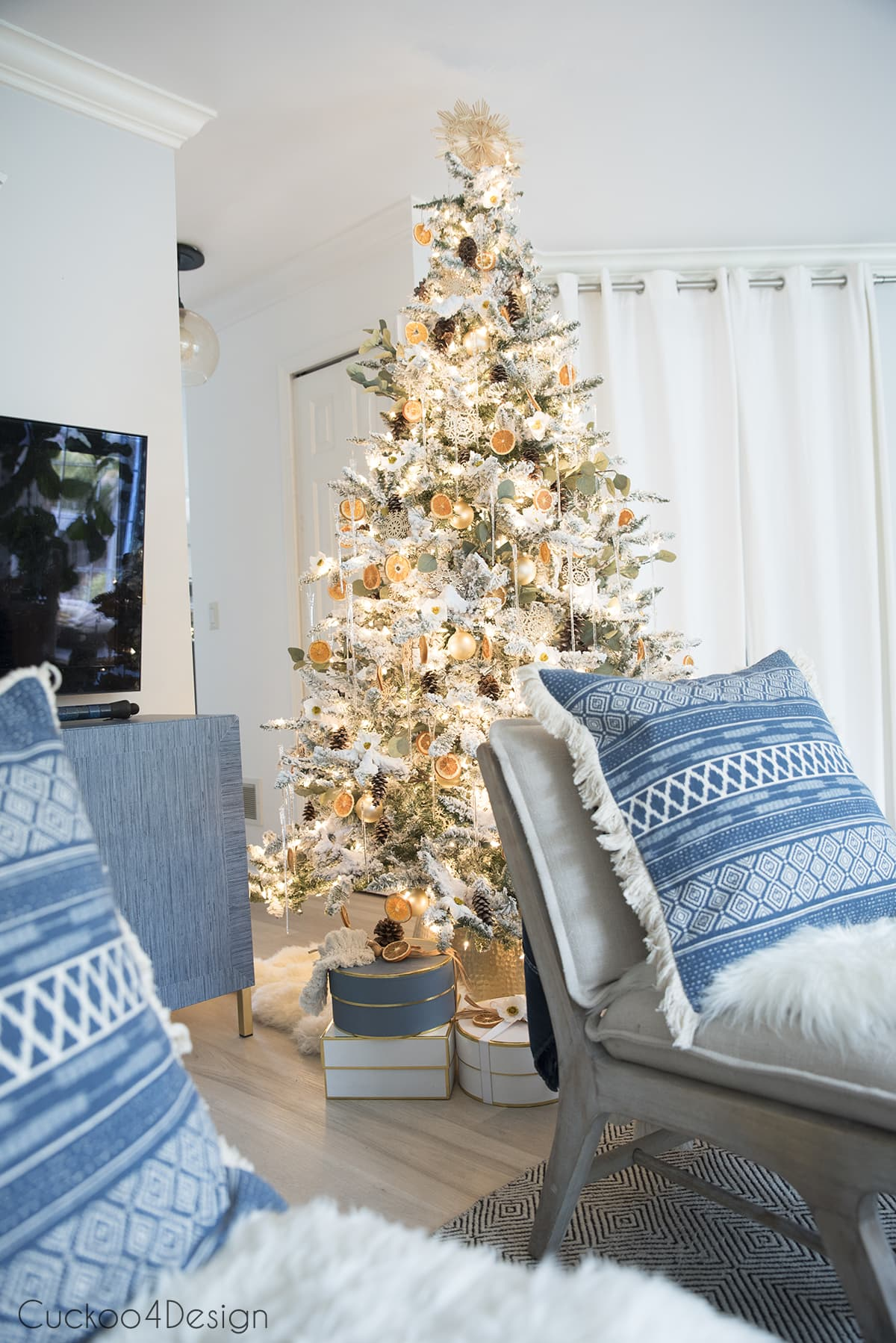 flocked German Christmas tree in modern boho home