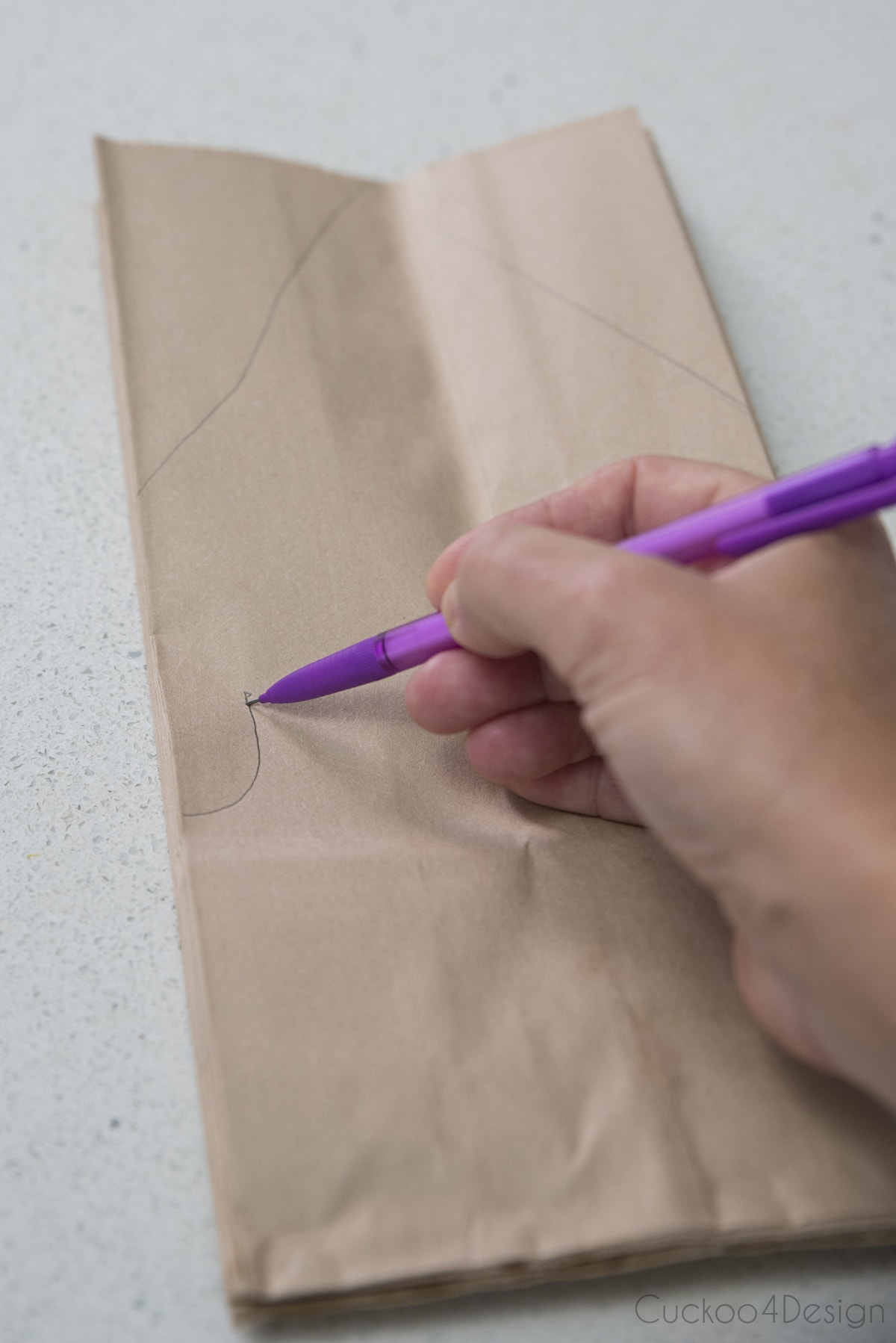 drawing the snowflake pattern onto the lunch bags