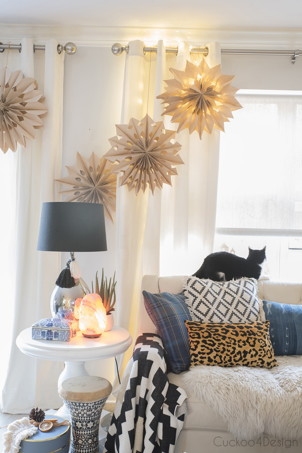 3D snowflakes hanging on living room curtain