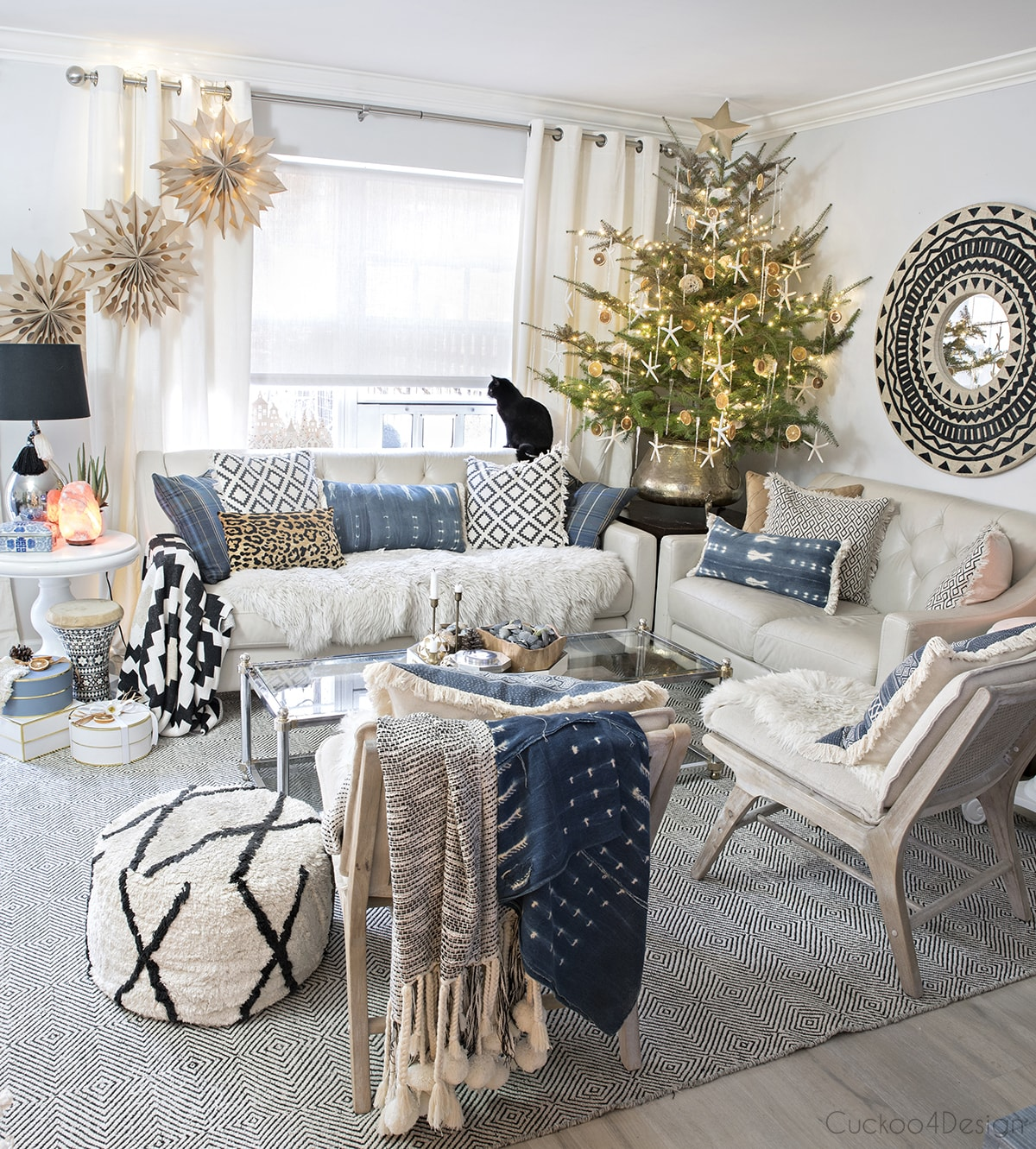 3D snowflakes hanging in neutral boho living room